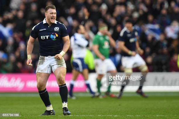 Scotland's full back Stuart Hogg celebrates after winning the Six Nations international rugby union match between Scotland and Ireland at Murrayfield...