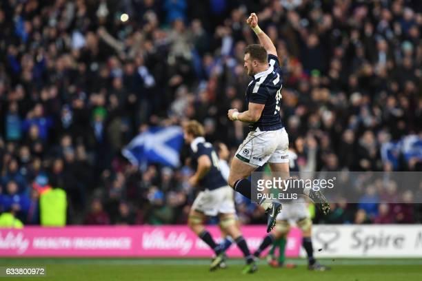 Scotland's full back Stuart Hogg celebrates after winning the Six Nations international rugby union match between Scotland and Ireland at Murrayfield...