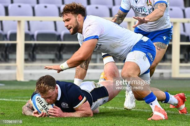 Scotland's full back Stuart Hogg grounds the ball over his own line under pressure from Italy's centre Federico Mori during the Autumn Nations Cup...
