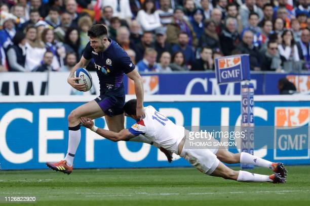 Scotland's fullback Blair Kinghorn runs to evade France's flyhalf Romain Ntamack during the Six Nations rugby union tournament match between France...