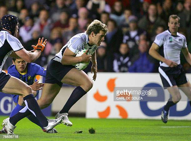 Scotland's fullback Rory Lamont avoids the tackle from Romania's winger Catalin Fercu during their rugby union World Cup group C match Scotland vs...