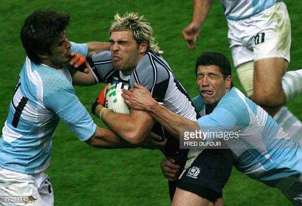 Scotland's fullback Rory Lamont is tackled by Argentina's winger Lucas Borges and Argentina's centre Manuel Contepomi during their Rugby union World...