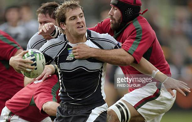 Scotland's fullback Rory Lamont vies with Portugal's number 8 and captain Vasco Uva during the rugby union World Cup match Scotland vs Portugal, 09...