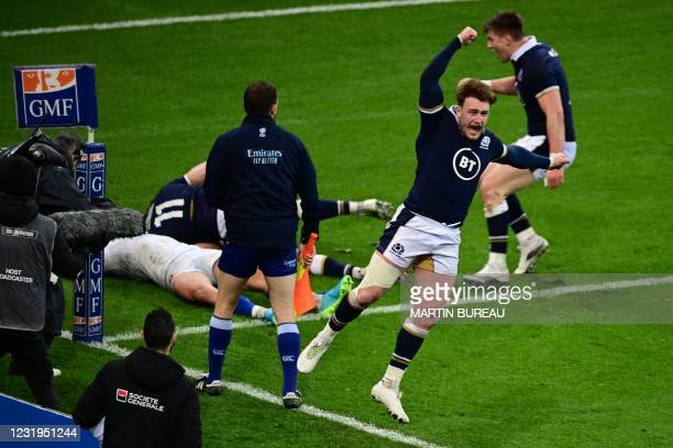 Scotland's full-back Stuart Hogg reacts as Scotland scores the winning try at the end of the Six Nations rugby union tournament match between France...