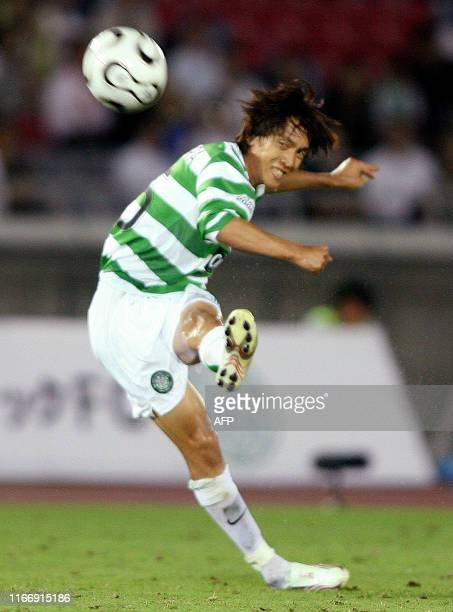 Scotland's Glasgow Celtic midfielder Shunsuke Nakamura fires a free kick against Japan's Yokohama Marinos during a friendly match at Yokohama's...