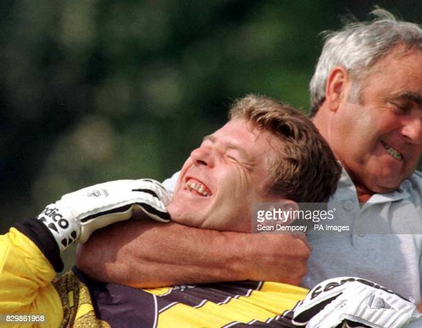 Scotland's goalkeeper Andy Goram is jokingly strangled by his coach Alan Hodgkinson during the team's training session at StratforduponAvon this...
