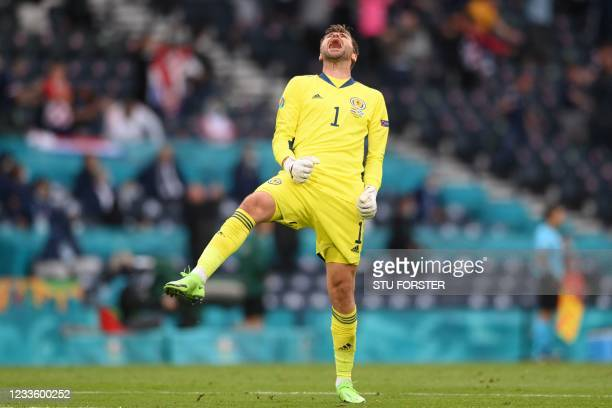 Scotland's goalkeeper David Marshall celebrates the equalising goal during the UEFA EURO 2020 Group D football match between Croatia and Scotland at...