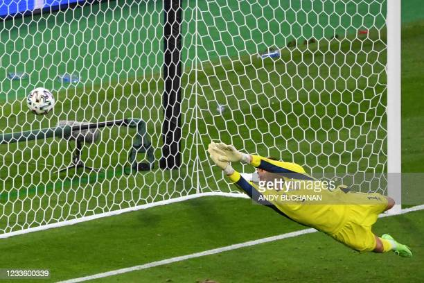 Scotland's goalkeeper David Marshall concedes a second goal during the UEFA EURO 2020 Group D football match between Croatia and Scotland at Hampden...