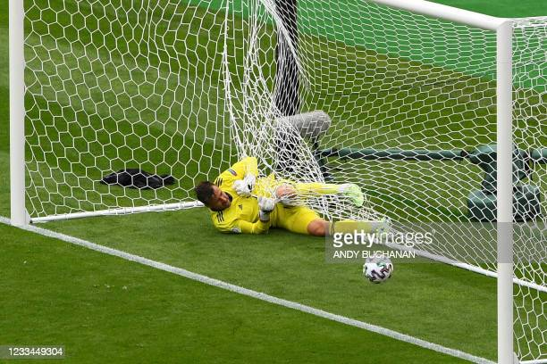 Scotland's goalkeeper David Marshall falls in the net after missing a save on Czech Republic's second goal during the UEFA EURO 2020 Group D football...