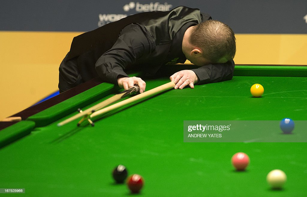 Scotland's Graeome Dott reacts after playing a shot during the World Snooker Championship 2013 second round match against England's Shaun Murphy at The Crucible in Sheffield, England, on April 26, 2013.