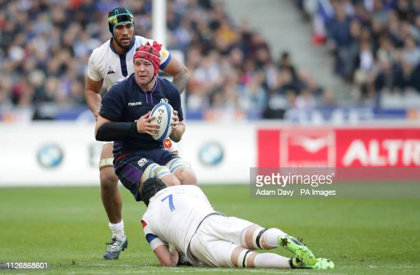 Scotland's Grant Gilchrist is tackled by France's Arthur Iturria during the Guinness Six Nations match at the Stade De France Paris