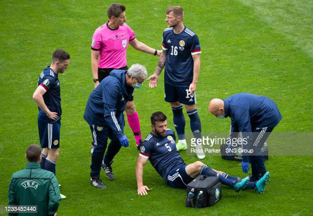 Scotland's Grant Hanley goes down with an injury during a Euro 2020 match between Scotland and Czech Republic at Hampden Park on June 14 in Glasgow,...