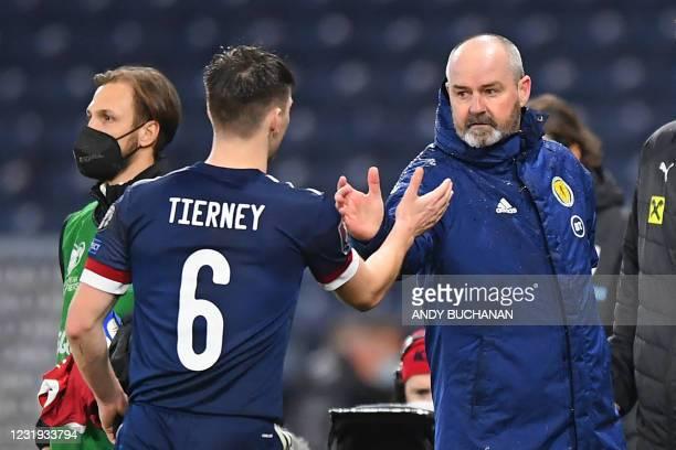 Scotland's head coach Steve Clarke congratulates Scotland's defender Kieran Tierney after the FIFA World Cup Qatar 2022 qualification football match...