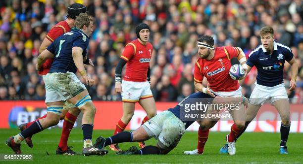 Scotland's hooker Fraser Brown tackles Wales' Scott Baldwin during the Six Nations international rugby union match between Scotland and Wales at...