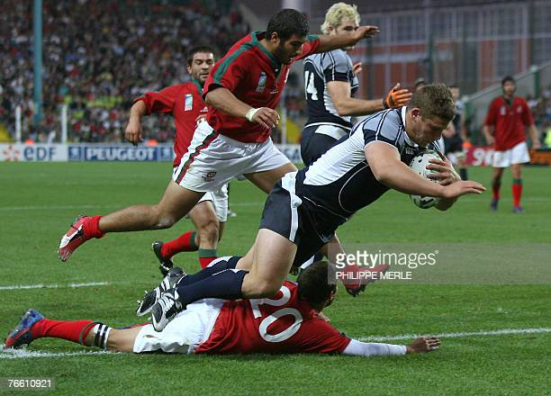 Scotland's hooker Ross Ford scores a try despite Portugal's scrum-half Luis Pissarra during the rugby union World Cup match Scotland vs. Portugal, 09...