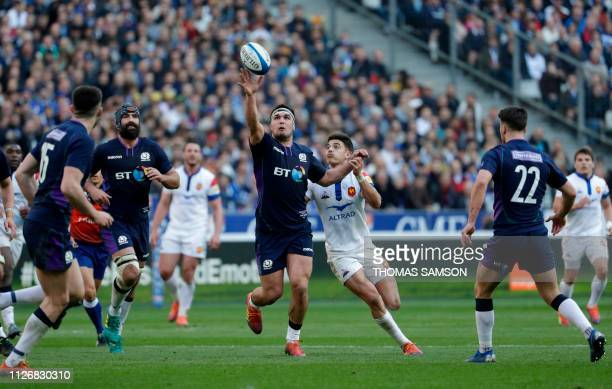 Scotland's hooker Stuart McInally vies with France's flyhalf Romain Ntamack during the Six Nations rugby union tournament match between France and...