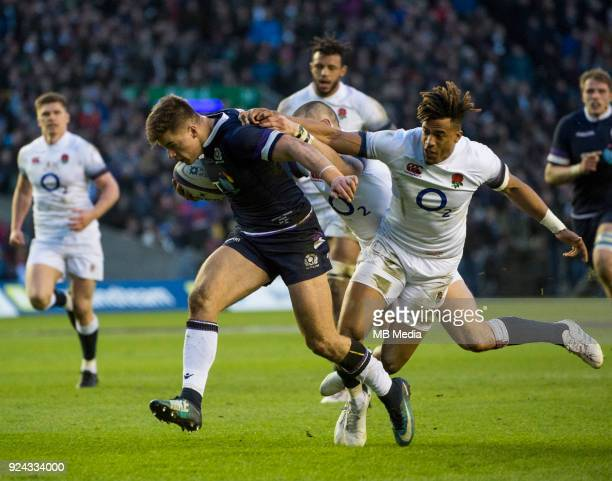 Scotland's Huw Jones breaks away from England Winger Anthony Watson to score his side's opening try during the first half of the 6 Nations clash...