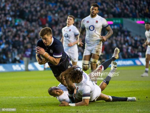 Scotland's Huw Jones dives over the line to score at BT Murrayfield on February 24 2018 in Edinburgh Scotland