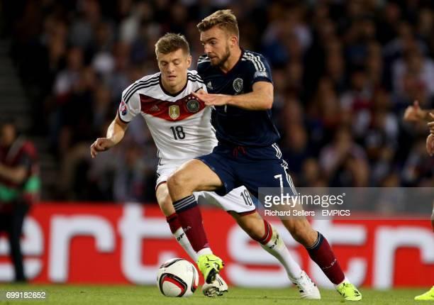 Scotland's James Morrison takes on Germany's Toni Kroos