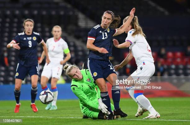Scotland's Jane Ross compeets with goalkeeper Oluva Joensen during a FIFA World Cup Qualifier between Scotland and Faroe Islands at Hampden Park on...