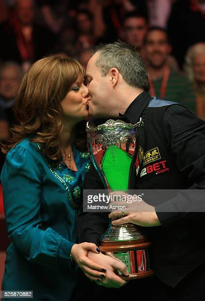 Scotland's John Higgins celebrates winning the 12BetCom UK Championship with a 10 frames to 9 victory over Mark Williams with his wife Denise