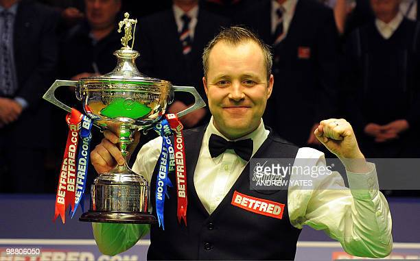 Scotland's John Higgins holds the trophy after beating Britain's Shaun Murphy 189 to win the World Championship Snooker final at the Crucible Theatre...
