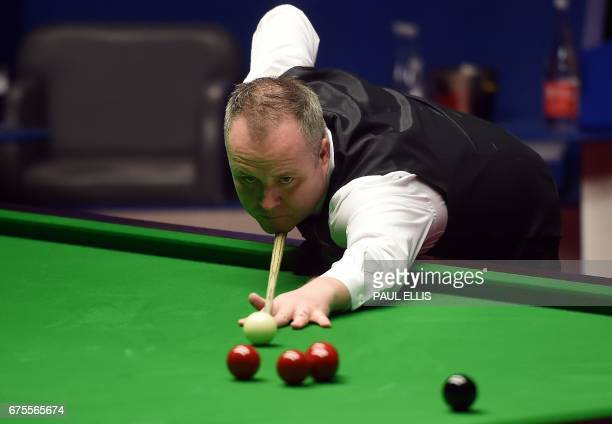 Scotland's John Higgins plays a shot during the World Championship Snooker final match against England's Mark Selby at The Crucible in Sheffield...