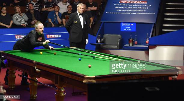Scotland's John Higgins plays during the World Championship Snooker final against England's Mark Selby at The Crucible in Sheffield England on May 1...