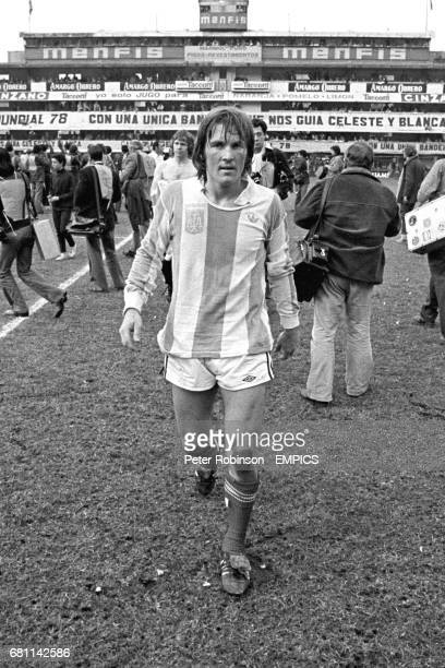 Scotland's Kenny Dalglish walks off after the match wearing an Argentina shirt