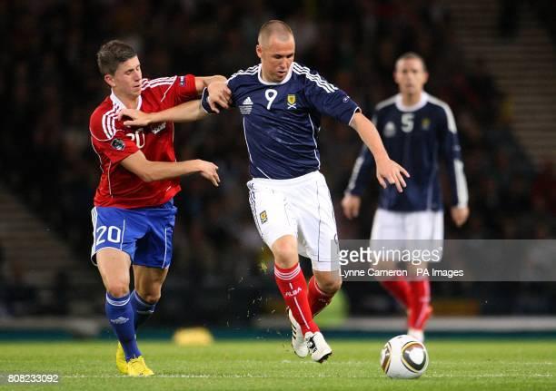 Scotland's Kenny Miller and Liechtenstein's Sandro Wieser battle for the ball