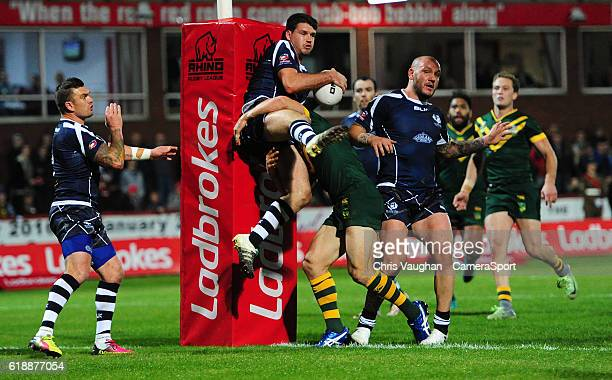 Scotland's Lachlan Coote is tackled by Australia's Matt Moylan during the Four Nations match between the Australian Kangaroos and Scotland at...