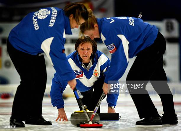Scotlands ladies team skipper Jackie Lockhart follows her stone behind sweepers Katriona Fairweather and Anne Laird in a tiebreak match against the...
