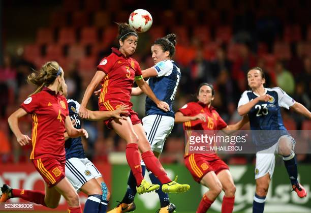 TOPSHOT Scotland's Leanne Crichton heads the ball with Spain's Marta Torrejon during the UEFA Women's Euro 2017 football match between Scotland and...
