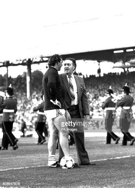 Scotland's legendary football manager Jock Stein chats to Welsh goalkeeper Neville Southall before the World Cup match at Ninian Park Cardiff Stein...
