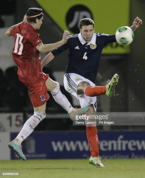 Scotland's Lewis Toshney and Luxembourgh's Ken Corral fight for the ball during the UEFA European Under 21's Qualifying match at St Mirren Park...