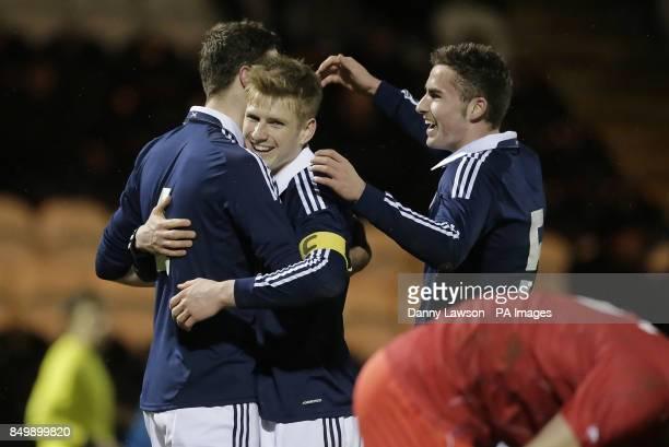 Scotland's Lewis Toshney celebrates his goal with team mates Scotland's Stuart Armstrong and Scotland's Clark Robertson during the UEFA European...