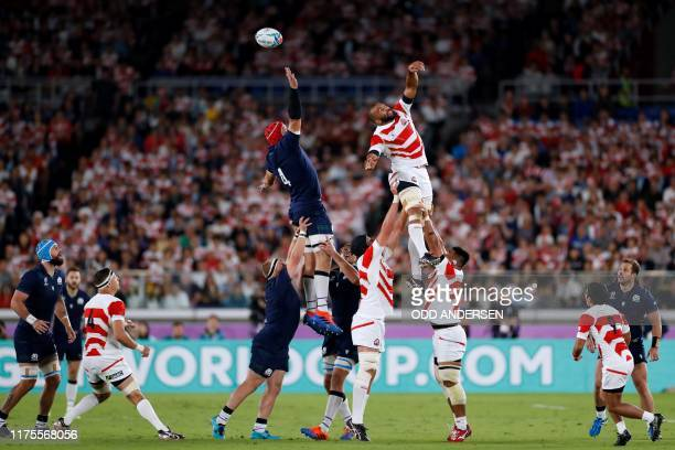Scotland's lock Grant Gilchrist and Japan's flanker Michael Leitch jump for the ball in a line out during the Japan 2019 Rugby World Cup Pool A match...