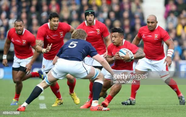 Scotland's lock Jonny Gray prepares to tackle Tonga's scrum half Tane Takulua during the Autumn International rugby union Test match between Scotland...