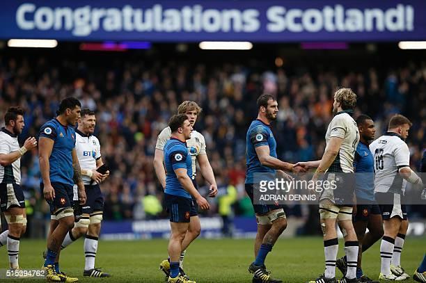 Scotland's lock Jonny Gray shakes hands with France's lock Yoann Maestri following the Six Nations international rugby union match between Scotland...