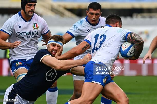 Scotland's lock Nick Haining tackles Italy's center Marco Zanon during the Autumn Nations Cup rugby union match Italy vs Scotland on November 14,...