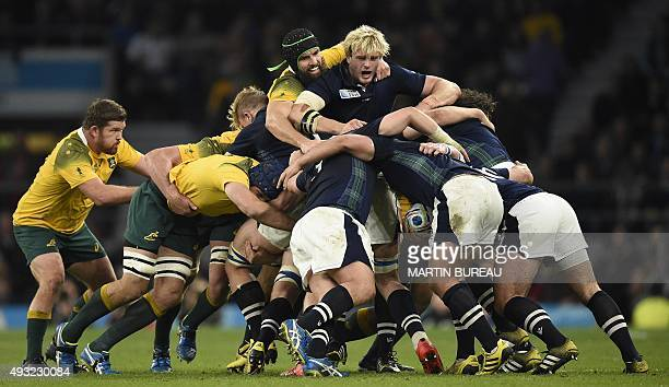 Scotland's lock Richie Gray and Australia's flanker Scott Fardy vie in a maul during a quarter final match of the 2015 Rugby World Cup between...