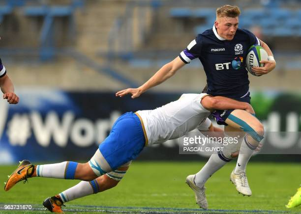 Scotland's Logan Trotter runs with the ball during the Rugby Union World Cup U20 championship match Scotland vs Italy at the Mediterranean stadium in...