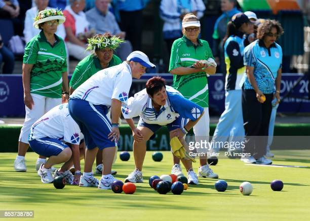 Scotland's Lorraine Malloy and Lauren Baillie urge a bowl on during the Women's Fours against the Cook Islands at the Kelvingrove Lawn Bowls Centre...