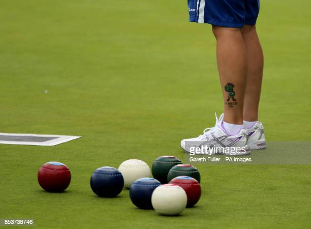 Scotland's Lorraine Malloy prepares to bowl in the Women's Fours against the Cook Islands at the Kelvingrove Lawn Bowls Centre during the 2014...