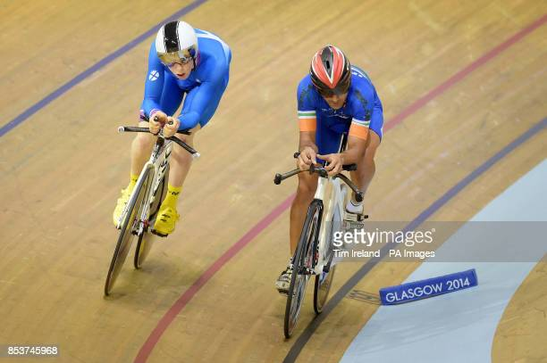 Scotland's Mark Stewart overtakes India's Sombir in the 4000m time trial qualifying at the Sir Chris Hoy Velodrome during the 2014 Commonwealth Games...