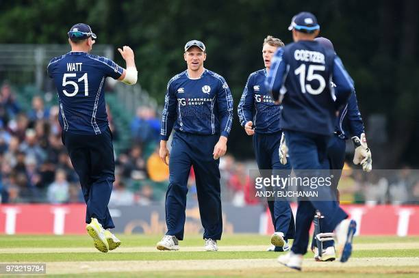 Scotland's Mark Watt celebrates with team mates after after taking the wicket of Pakistan's Hussain Talat for 17 runs during the second Twenty20...