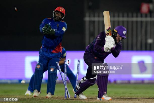 Scotland's Mark Watt is clean bowled by Afghanistan's Mujeeb Ur Rahman as Afghanistan's wicketkeeper Mohammad Shahzad watches during the ICC mens...