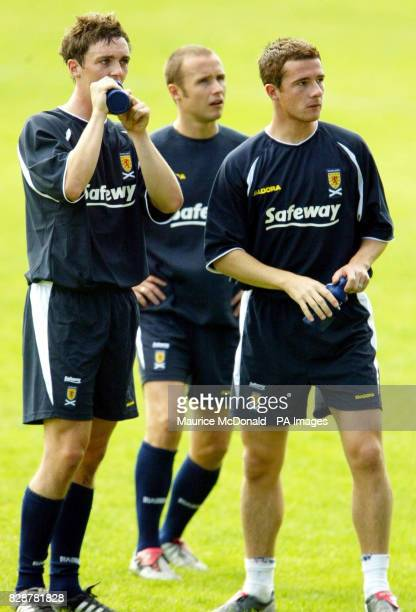 Scotland's Maurice Ross Barry Ferguson and Paul Devlin during a training session at Westfalia Herne in Germany ahead of their Euro 2004 qualifying...