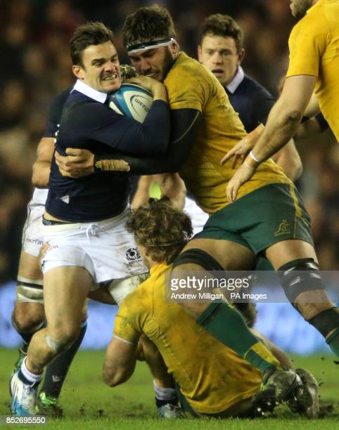 Scotland's Max Evans is tackled by Australia's Rob Simmons during the viagogo Autumn Test match at Murrayfield, Edinburgh.