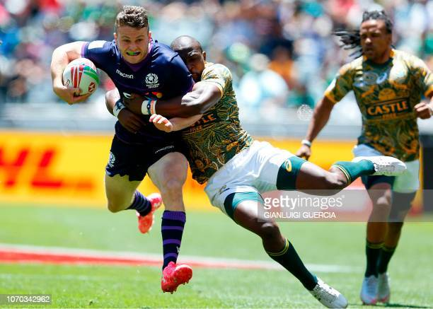 TOPSHOT Scotland's Max Mcfarland is tackled by South Africa's Siviwe Soyzwapi during the quarter final between Scotland and South Africa on the...